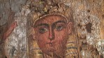 Restoration of Egyptian shroud.