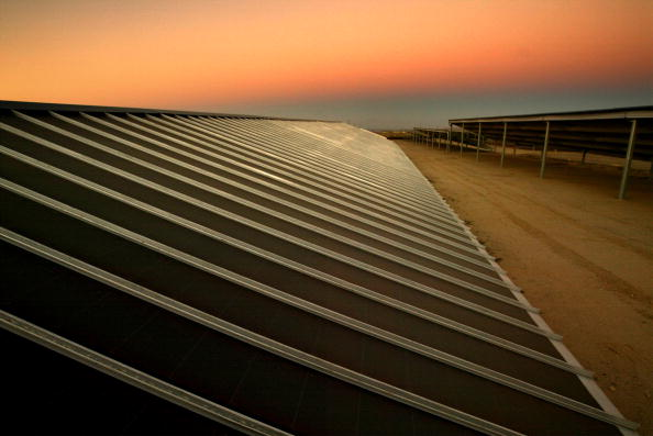 Night settles over solar panals at Solarmine, the first solar photovoltaic facility in California to help power oil field operations, on July 8, 2003 near Taft, California, 40 miles west of Bakersfield.