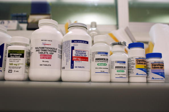 Bottles of antibiotics line a shelf at a Publix Supermarket pharmacy August 7, 2007 in Miami, Florida