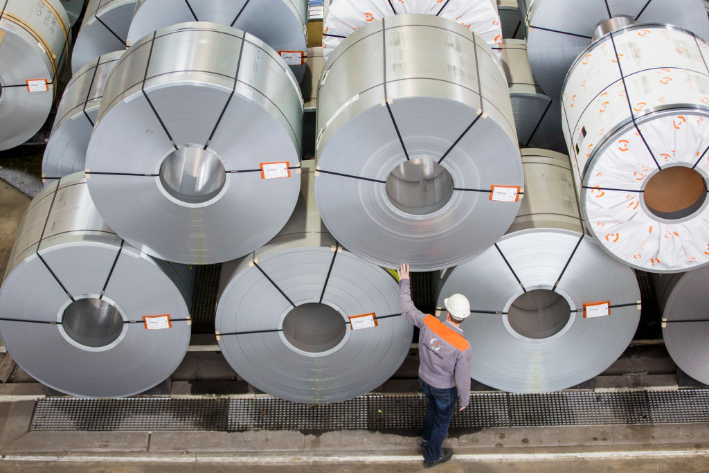 A worker poses for photo at steel rolls at the Salzgitter AG steelworks on March 7, 2017 in Salzgitter, Germany. Salzgitter is among Europe's biggest steel producers.