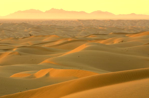 The rising sun illuminates the Algodones Dunes, also known as the Imperial Dunes or American Sahara.