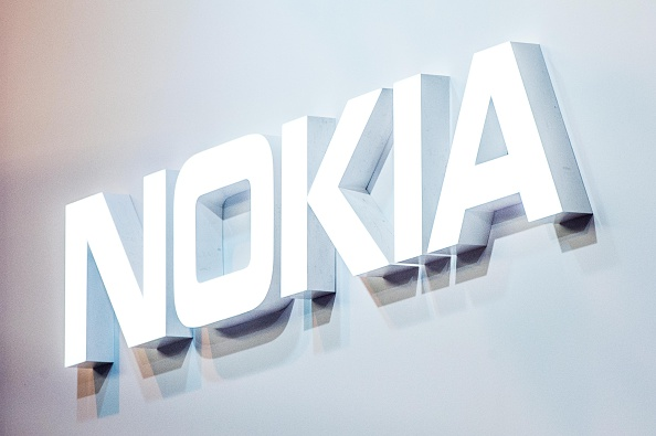 A logo sits illuminated outside the Nokia pavilion on the opening day of the World Mobile Congress at the Fira Gran Via Complex on February 22, 2016 in Barcelona, Spain
