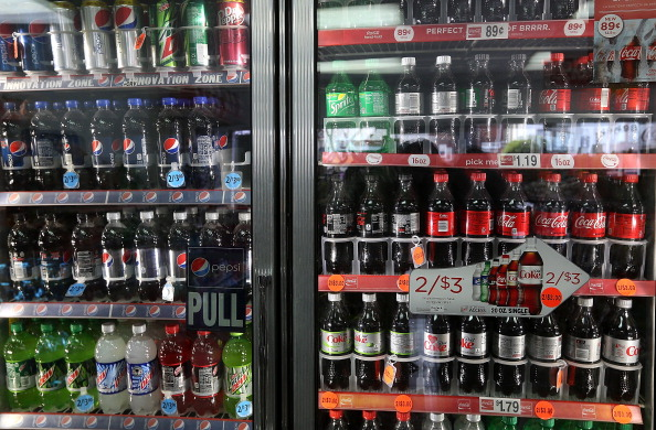 Different brands of soda on display in a convenience store