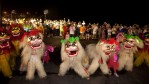 A Dragon and Lion dance is performed before a ceremony releasing water lanterns into the sea to celebrate the mid-summer Ghost Month Festival on August 20, 2013 in Keelung, Taiwan.