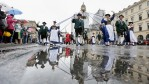 Members of a traditional Bavarian costume association (Trachtenverein) participate, reflected by rain puddles, in the annual riflemen's parade of the Oktoberfest 2016 beer festival in Munich, Germany.