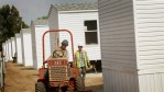 Workers build a mobile home community for FEMA homes near the airport July 29, 2011 in Joplin, Missouri