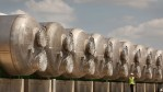 A worker walks next to a row of horizontal pressure filters at Britain's first-ever mainland de-salination plant, which is known as the Thames Gateway Water Treatment