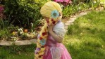 A little girl battling with cancer wearing her Disney princess-inspired wig made by volunteers from The Magic Yarn Project
